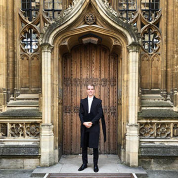 Jack Kelly outside an entrance to the Bodleian Library